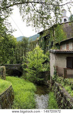 Old stone bridge at Riva San Vitale (Ticino Switzerland) along the Lake of Lugano (Ceresio). poster
