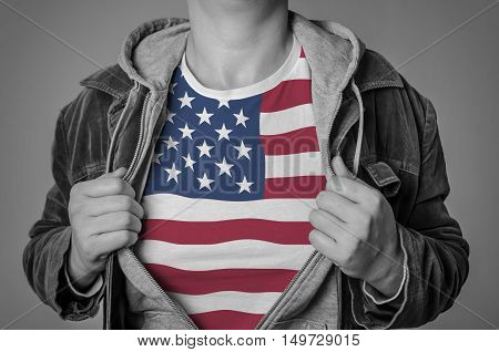 Man showing American flag on t-shirt. Concept for patriotism freedom and national pride.