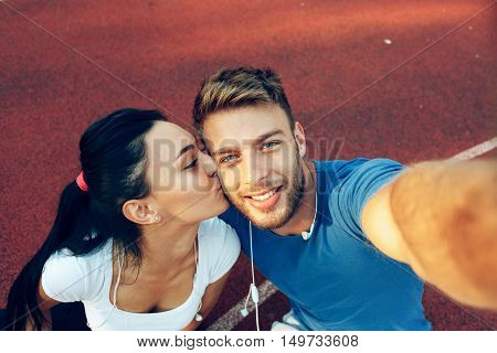 Selfie of young happy couple outdoor during the day