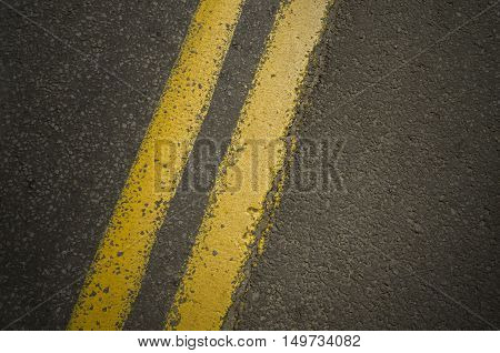 Double yellow line on asphalt road with copy space.