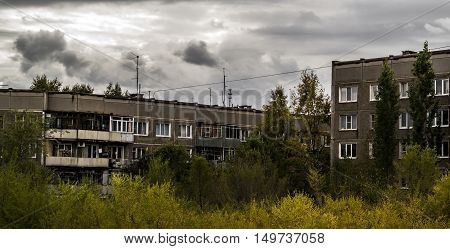 View of the old public housing, autumn, houses, housing complex, municipal housing, cheap accomodation, social housing, autumn landscape, cityscape, dramatic sky. Apartment buildings