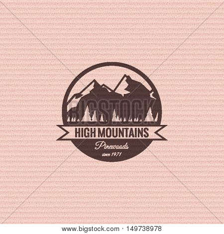 Mountain logo on the cardboard texture background. Stock vector.