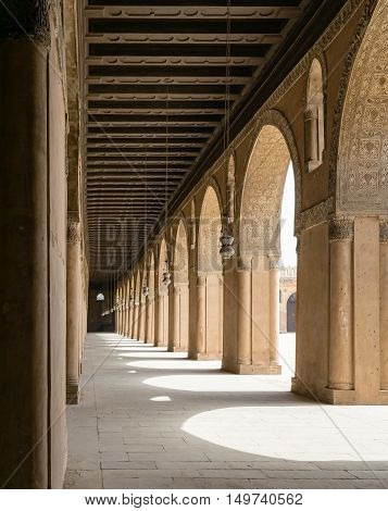 Cairo, Egypt - September 12, 2015: One of the passages surrounding the courtyard of the Mosque of Ahmad Ibn Tulun the largest mosque in Cairo Egypt