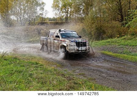 Rally 4Wd Car  Boosts Water Hurdle Surrounded By Splashes.