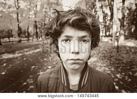 preteen boy dramatic sad close up black and white autumn outdoor portrait