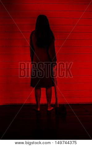 Girl with hatchet,Scary background for halloween concept and book cover ideas