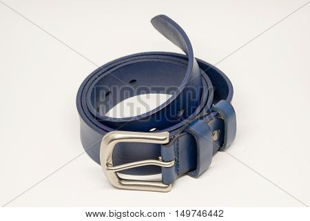 Blue belt leather and silver buckle on white background.