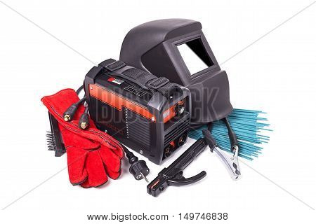 Inverter welding machine, welding equipment, isolated on a white background, welding mask, leather gloves, welding electrodes, high-voltage wires with clips, set of accessories for arc welding poster