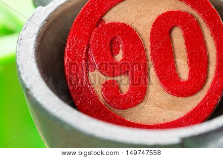 ninety, a red bingo number in wood