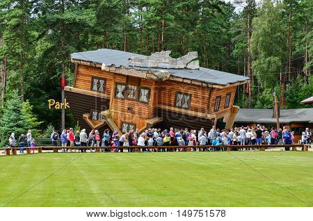 12 August 2016 Szymbark-Poland Famous touristic attraction in Szymbark open air museum - House on Roof  which can be entered and offers surrealistic and dizzy sensations to visitors. Editorial photo.