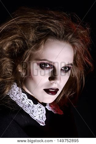 Horror shot: closeup portrait of a scary gothic girl