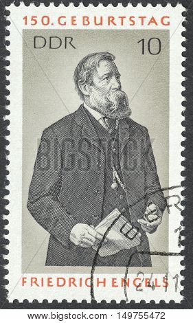 MOSCOW RUSSIA - CIRCA SEPTEMBER 2016: a stamp printed in DDR shows a portrait of Friedrich Engels the series