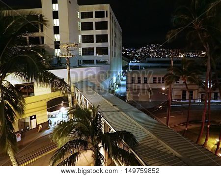 HONOLULU HI - JANUARY 1 2016: Aerial view of The Dole Cannery building at night on island of Oahu in the state of Hawaii. Formerly a canning complex it is now an office and retail complex that offers specialty shops superstores entertainment eateries and