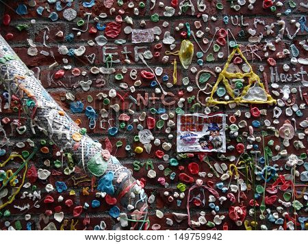 SEATTLE- JUNE 24 : Close-up of The Market Theater Gum Wall with Big League crew in downtown Seattle on June 24 2016. It is a local landmark in downtown Seattle in Post Alley under Pike Place Market.