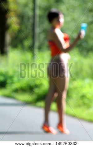 Abstract high key blurred image of young girl making selfie.  Summerday  in germany. Unrecognizable face.