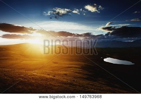 Sunset time over the mountains lake. Siberia, Altay region, Russia
