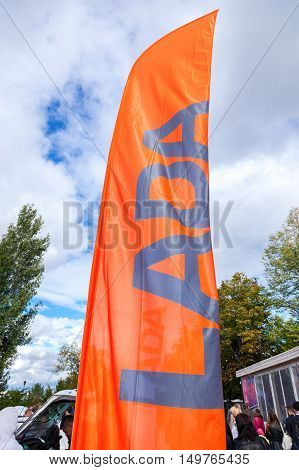 SAMARA RUSSIA - SEPTEMBER 11 2016: Official dealership flags of car manufacturer Lada against the blue sky background