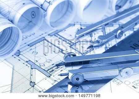 rolls of architecture blueprints, house plans &  compasses