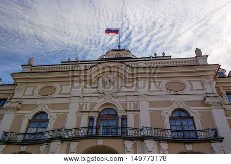 Konstantinovsky Palace in Strelna St. Petersburg. The residence of the President of Russia. The facade of the palace facing the Gulf of Finland decorated with the coat of arms and a flag on the steeple.