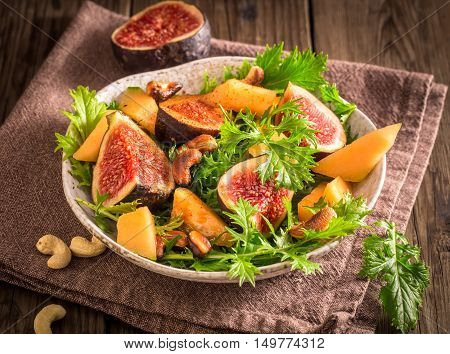 Fresh fig and melon salad with mizuna and smoky cashews
