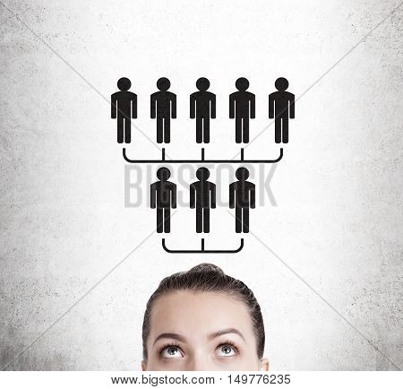Close up of woman's head that is the top of upside down pyramid. Concept of networking and structure.