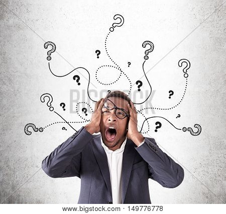 Overwhelmed African American Man With Question Marks