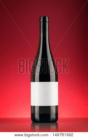 red wine bottle over the  red background