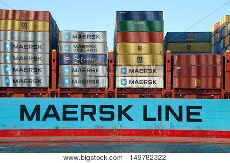 Oakland CA - September 29 2016: Cargo ship GERNER MARSK departing the Port of Oakland. Maersk is the largest container ship operator in the world currently in the process of splitting it's shipping and energy interest into separate divisions.