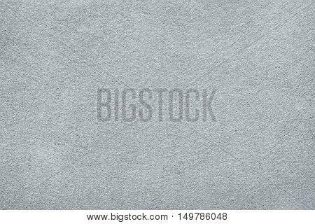 White or light gray felt background. Carpet table surface or fabric texture