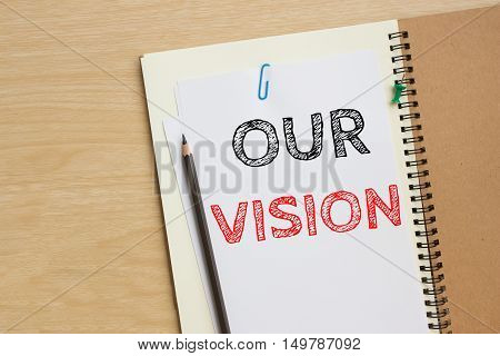 Text our vision on white paper and pencil / business concept