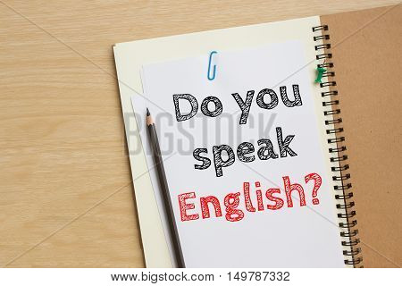 Text do you speak english on white paper and pencil / business concept