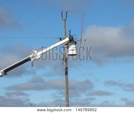 A lineman working on the rural power distribution system from a bucket truck.