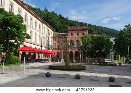 BAD WILDBAD GERMANY - JUNE 28 2015: the square Kurplatz Palais Thermal former Badhotel Baden-Wuerttemberg Schwarzwald Black Forest