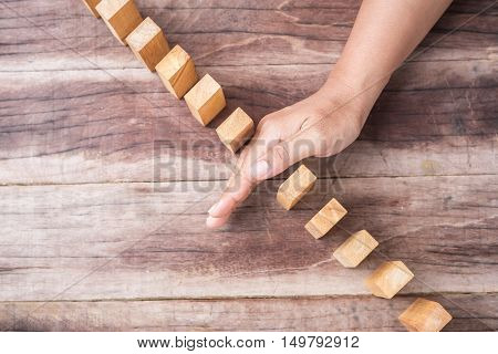 Hand Stop Wooden Block. Domino Risk Effect Concept