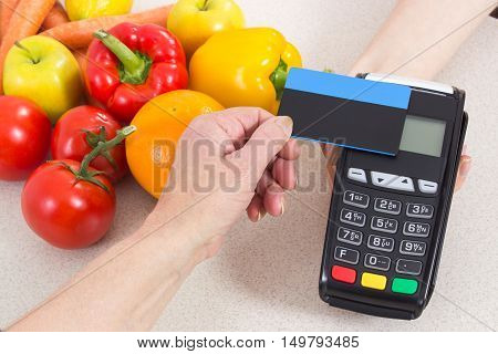 Hand Of Senior Woman Using Payment Terminal With Contactless Credit Card, Paying For Shopping