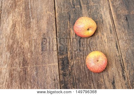 Red Apple on wooden background top view with copy space.
