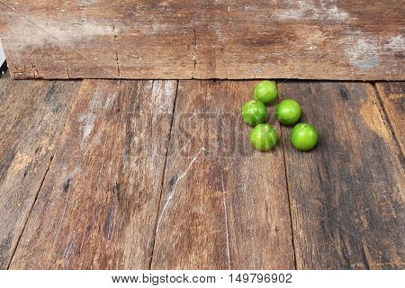 limes on the wooden table top view