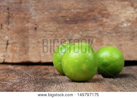 lime closeup Select focus with shallow depth of field on the wooden
