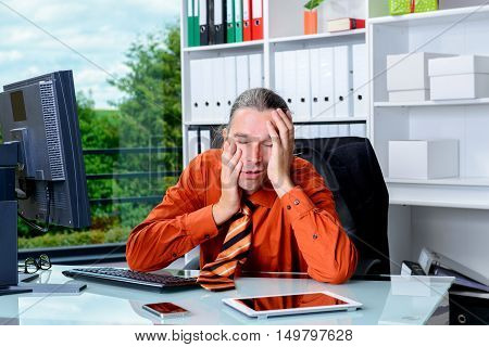 Tired Business Man Lying With Head In Hands Is Over-worked