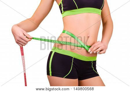 Woman measures the abdominal circumference centimeter tape, isolated on white background