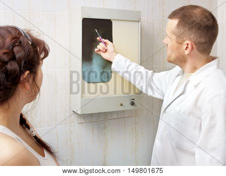 Doctor showing patient x-ray , close up