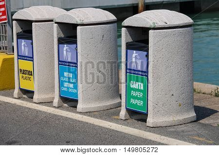 Piombino Italy - June 30 2015: Bins for different types of garbage on the pier