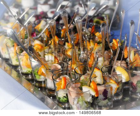 Wedding fish food composition in small glasses