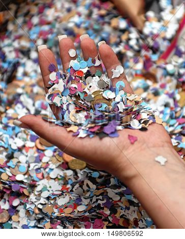 Hand With Carnival Confetti And Money