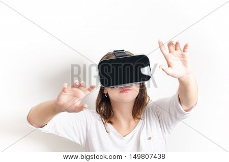 Woman with virtual reality goggles. Isolated. White background. Studio Woman show a gesture.