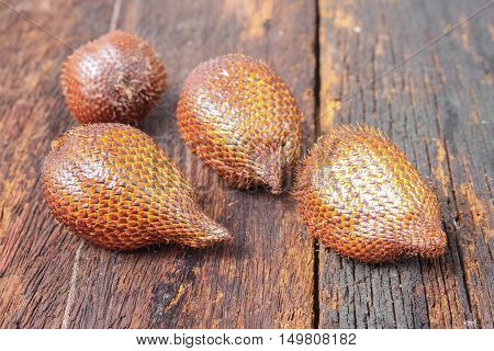Salak, Sala, Palm Closeup, Asian fruit (Salacca zalacca) on the wooden floor background