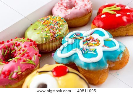 Six delicious, the colorful and bright donuts.