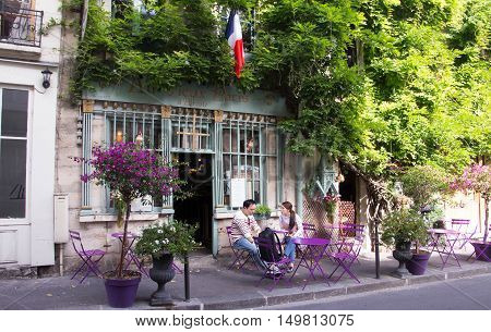 Paris France-September 27 2016 : The old traditional French cafe Au vieux Paris d'Arcole located in a touristy area near Notre Dame cathedral on Cite island.