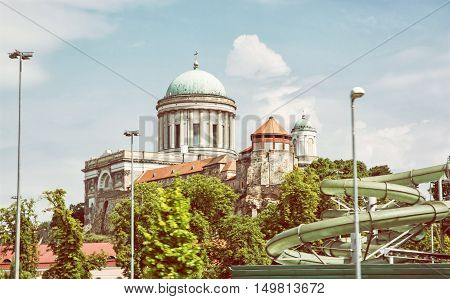 Beautiful basilica and water slide in the thermal spa and baths in Esztergom Hungary. Cultural heritage. Yellow photo filter. Travel and recreation. Leisure activity.