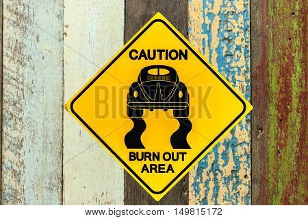 Roadsign race on texture and wood background